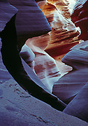 Sandstone jaws of a slickrock slot canyon, Lower Antelope Canyon, Colorado Plateau, Arizona.