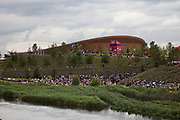 London 2012 Olympic Park in Stratford, East London. The scale of the landscape at the site is impressive as the crowds of peole look minute in front of the velodrome.