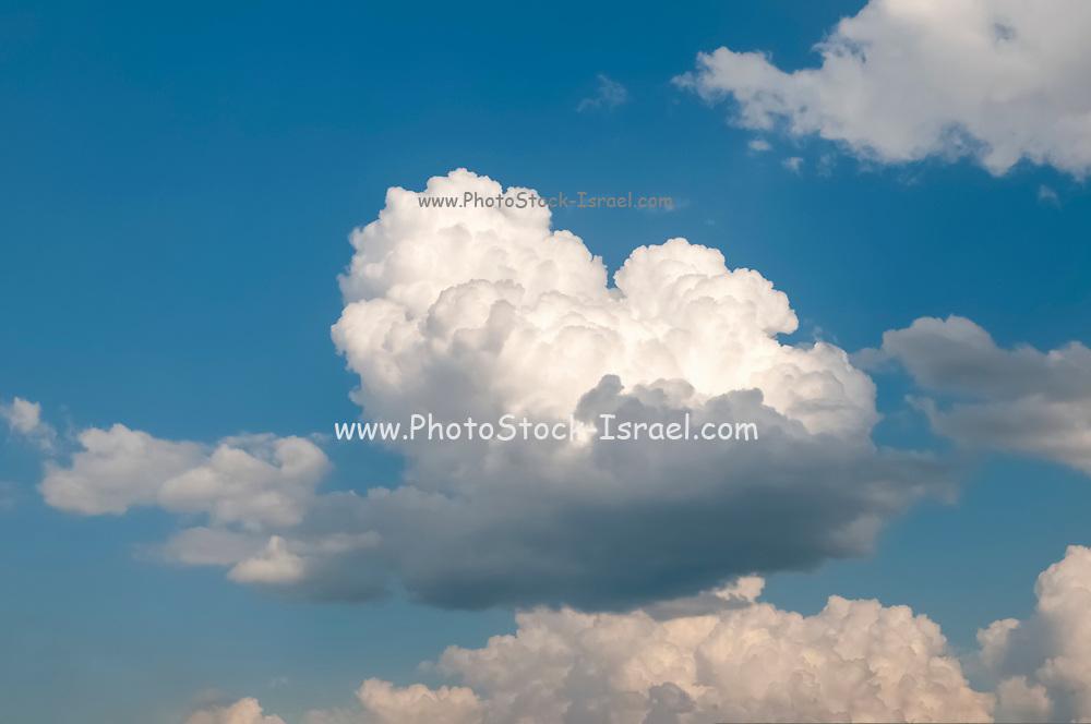 Beautiful cumulus cloudscape on a blue sky background. Photographed in Tyrol, Austria