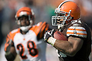 Cleveland running back Jamal Lewis, right, runs 66 yards for a touchdown while being chased by Cincinnati's Dexter Jackson in the third quarter..The Cleveland Browns defeated visiting Cincinnati 51-45, Sunday, September 16, 2007..