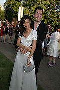 THANDIE NEWTON AND OLIVER PARKER, The Summer Party in association with Swarovski. Co-Chairs: Zaha Hadid and Dennis Hopper, Serpentine Gallery. London. 11 July 2007. <br />