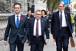 © Licensed to London News Pictures. 28/10/2019. London, UK. Chairman of the European Research Group (ERG) Steve Baker MP (L) walks with Mark Francois MP and Bill Cash MP (R) through Westminster. Photo credit : Tom Nicholson/LNP