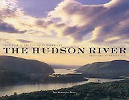 """The Hudson River: From Tear of the Clouds to Manhattan, Signed By Jake Rajs, Introduction by Joan Davidson<br /> <br /> Celebrated as the American Rhine, the majestic Hudson River flows more than three hundred miles from its source high in the Adirondack Mountains to New York Harbor. Lining its banks are the marks of the four hundred years of history that have transpired since Henry Hudson piloted the Half Moon north from New Amsterdam in 1609. Today the river and the surrounding valley are protected as a National Heritage Area by the National Park Service.<br /> <br /> This stunning photographic journey explores the Hudson River's historic riverfront towns, stately mansions, public parks, and pristine wilderness. The images follow the course of the river and are paired with writings and poetry by such distinguished writers as Washington Irving, Charles Dickens, and Robert Caro.<br /> <br /> First published in a deluxe edition in 1996, this unique presentation is now accessible to all who admire the beauty and power of this magnificent landscape.<br /> <br /> Review: Picture books about the Hudson have been appearing since the publication of Wade and Croomes's """"Panorama f the Hudson Valley"""" in 1846. But """"the Hudson River"""" with 250 color photographs by Jake Rajs…. Is the most handsome of them all."""" New York Times Dec 10, 1995"""