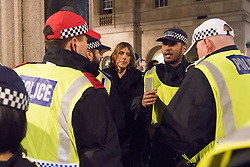 London, November 5th 2016. Anti-capitalists and anarchists participate in the Million Mask March, an annual event that happens on November 5th each year in cities across the world, as part of a protest against the establishment. Many of the protesters wear Guy Fawkes masks, often associated with the internet activism group Anonymous. PICTURED: A man is arrested after climbing a statue in Whitehall.