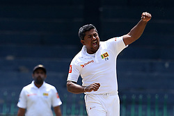 July 16, 2017 - Colombo, Sri Lanka - Sri Lanka's Rangana Herath,(Right), celebrates taking the wicket of Zimbabwe's Hamilton Masakadza(unseen) during the third day's play of the only test cricket match between Sri Lanka and Zimbabwe in Colombo, Sri Lanka, Sunday, July 16, 2017. (Credit Image: © Tharaka Basnayaka/NurPhoto via ZUMA Press)