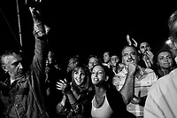 Palermo, Italy, 25 October 2012: People clap their hands during a speech of founder of the Five Stars Movement Beppe Grillo, 64, supporting candidate for Governor of Sicily Giancarlo Cacielleri, a 37 years old surveyor from Caltanisetta,  in Piazza Magione Palermo, Italy, on October 25 2012. Beppe Grillo, a comedian turned political guru, Grillo campaigned actively in Sicily, swam across the channel that separates the island from the rest of Italy, scaled its active volcano, Mount Etna, and drawed thousands of Sicilians to campaign rallies for his derisive stand-up routines.<br /> <br /> The direct elections in Sicily for the President of the Region and its representatives will take place on Sunday 28 October 2012, 6 months ahead of the end of the terms of office of the current legislature. The anticipated election of October 28 take place after Raffaele Lombardo, former governor of Sicily since 2008, resigned on July 31st. Raffaele Lombardo is under investigation since 2010 for Mafia ties. His son Toti Lombardo is currently running for a seat in the Sicilian Regional Assembly in the coalition of Gianfranco Micciché, a candidate for the Presidency of the Region. 32 candidates belonging to 8 of the 20 parties running for the Sicilian elections are either under investigation or condemned. ### Palermo, Italia, 25 ottobre 2012: il pubblico applaude il fondatore del Movimento 5 Stelle Beppe Grillo, 64 anni, durante  un comizio in Piazza Magione per sostenere il candidato alla Presidenza della Regione Sicilia Giancarlo Cancelleri, un geometra di 37 anni di Caltanisetta, a Palermo il 25 ottobre 2012.<br /> <br /> Le elezioni in Sicilia per la votazione diretta del presidente della regionee dei deputati all'Assemblea regionale (ARS)si terranno domenica 28 ottobre, in anticipo sulla scadenza naturale dell'attuale legislatura, prevista ad aprile dell'anno prossimo. In Sicilia si vota in anticipo dopo le dimissionidel 31 luglio scorso di Raffaele Lombardo, eletto presidente de