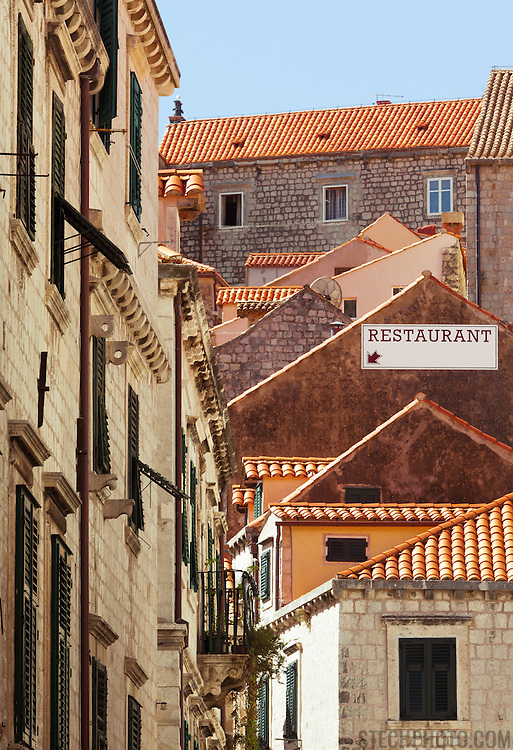 """A view of old character buildings down a street in the old city of Dubrovnik, Croatia.<br /> <br /> Dubrovnik serves as the official setting of """"King's Landing"""" from the popular TV show """"Game of Thrones""""."""