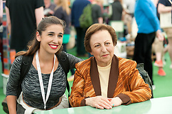 © Licensed to London News Pictures. 28/05/2016. Hay-on-Wye, Powys, Wales, UK. Iranian human rights lawyer and activist poses for a photo with a photographer in the bookshop at The  2016 Hay Festival. Fine weather on the third day of the Hay Festival at Hay-on-Wye, Wales. Photo credit: Graham M. Lawrence/LNP