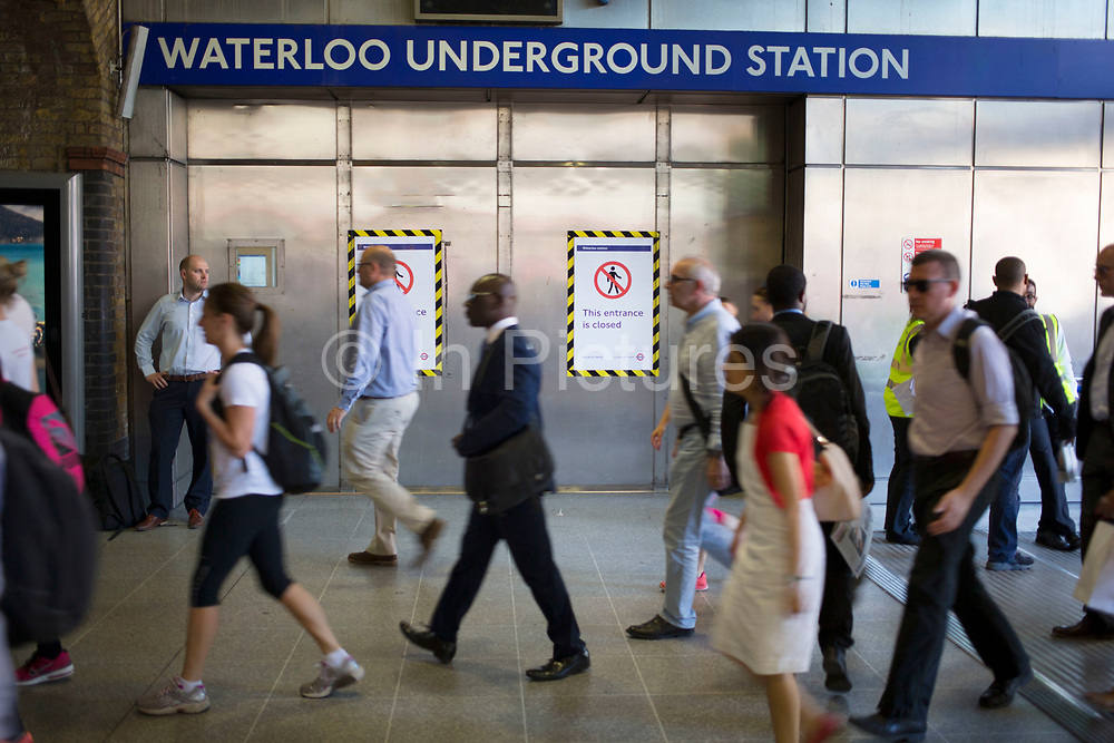London, UK. Thursday 9th July 2015. Tube and train strikes caused misery for commuters with the entire London Underground network shut down and many rail services cancelled. The strike was in protest at longer working hours announced due to the tube system being open all night on weekends. Crowds of people pour into Waterloo mainline station but the doors to the underground are closed.