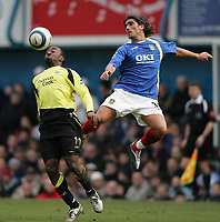 Photo: Lee Earle.<br /> Portsmouth v Manchester City. The Barclays Premiership. 11/03/2006. Pompey's Pedro Mendes (R) clears from Darius Vassell.