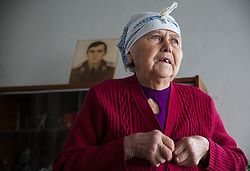 A photograph of Nina Morozova's son takes pride of place in her apartment in Debaltsevo. Her son, serving in the Russian army, is unable to visit her since the conflict in Ukraine began.