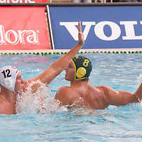 Balazs Harai (L) of Hungary fights against Samuel McGregor (R) of Australia during the Vodafone Waterpolo Cup in Budapest, Hungary on July 17, 2012. ATTILA VOLGYI