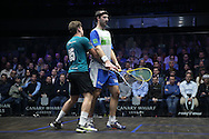 Simon Rosner of Germany (in the white shirt) and Charles Sharpes of England (in the Green shirt) clash during play. Canary Wharf Squash Classic 2016 , day two at the East Wintergarden in Canary Wharf , London on Tuesday 8th March 2016.<br /> pic by John Patrick Fletcher, Andrew Orchard sports photography.