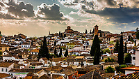 Looking over the rooftops of Granada, Granada Province, Andalusia, Spain.