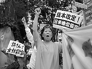 July 4, 2016, Tokyo, Japan: A group of nearly 100 activists staged a protest in front of Japan's Ministry of Defense to vent their frustrations about US military bases in Okinawa and the recent murder of Rina Shimabukuro, a 20 y/o local woman whose accused killer is American contractor Kenneth Franklin Gadson. This demo was held in tandem with a rally that took place in Okinawa at the same time with a call for the closure of the US Marine Corps Air Station Futenma, cancelation of the plan to move Futenma?s operations to Henoko town on the northern end of the island, and the a revision of the US Japan Armed Forces Agreement concerning all US military in Okinawa. These activists claim that relocating the Futenma base to Henoko will altar the ecosystem of the Yanbaru forest where protected birds habitate, as well as cause irreversible harm coral reefs where the endangered dudong lives, a type of Okinawan manatee. (Torin Boyd/Polaris).