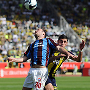 Trabzonspor's Serkan BALCI (L) and Fenerbahce's Ozer HURMACI (R) during their Turkey Cup final match Trabzonspor between Fenerbahce at the GAP Arena Stadium at Urfa Turkey on wednesday, 05 May 2010. Photo by TURKPIX