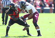 Southern Illinois Salukis tight end MyCole Pruitt (4, right) blocks Southeast Missouri State Redhawks defensive back Cantrell Andrews (24). The Southern Illinois University - Carbondale (SIUC) Salukis defeated the host Southeast Missouri State University (SEMO) Redhawks 36-19 in an NCAA football game at Busch Stadium on Saturday September 21, 2013.