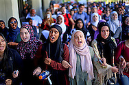 Students chant while marching at a rally against Islamophobia at San Diego State University in San Diego, California November 23, 2015.  REUTERS/Sandy Huffaker