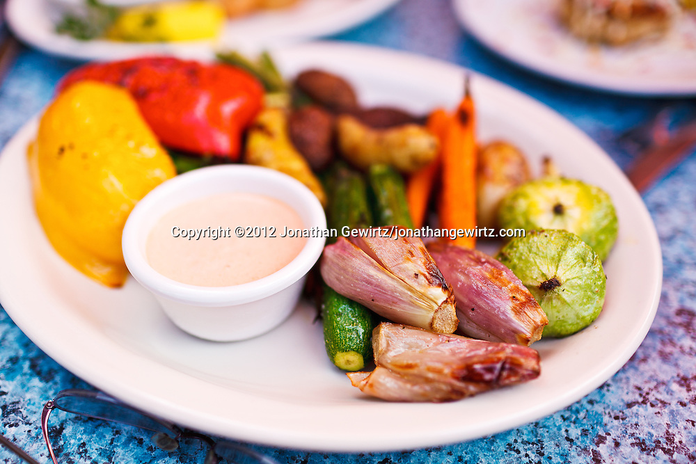 A plate of roasted vegetables on a restaurant table. WATERMARKS WILL NOT APPEAR ON PRINTS OR LICENSED IMAGES.
