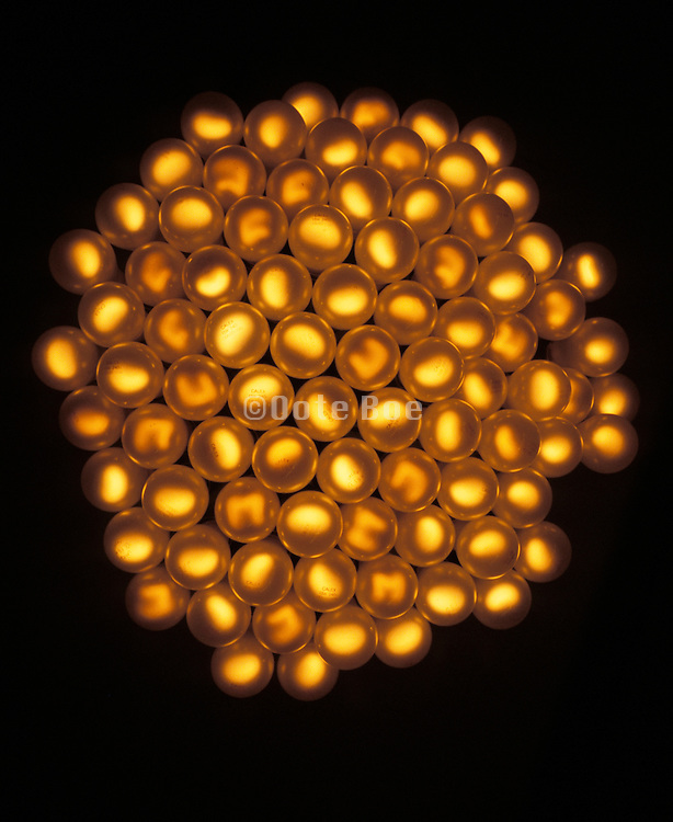 a bundle of light bulbs bundled together and lightly glowing