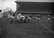 Irish Rugby Football Union, Ireland v England, Five Nations, Landsdowne Road, Dublin, Ireland, Saturday 14th February, 1959,.14.2.1959, 2.14.1959,..Referee- D Gwynne Walters, Welsh Rugby Union, ..Score- Ireland 0 - 3 England, ..Irish Team, ..N J Henderson, Wearing number 15 Irish jersey, Full back, N.I.F.C, Rugby Football Club, Belfast, Northern Ireland,..N H Brophy, Wearing number 14 Irish jersey, Right wing, University College Dublin Rugby Football Club, Dublin, Ireland, ..A J O'Reilly, Wearing number 13 Irish jersey, Right Centre, Old Belvedere Rugby Football Club, Dublin, Ireland, and, Leicester Rugby Football Club, Leicester, England, ..J F Dooley, Wearing  Number 12 Irish jersey, Left Centre, Galwegians Rugby Football Club, Galway, Ireland, ..A C Pedlow, Wearing number 11 Irish jersey, Left wing,  C I Y M S Rugby Football Club, Belfast, Northern Ireland, ..M A English, Wearing number 10 Irish jersey, Outside Half, Bohemians Rugby Football Club, Limerick, Ireland,..A A Mulligan, Wearing number 9 Irish jersey, Scrum Half, London Irish Rugby Football Club, Surrey, England, ..B G Wood, Wearing number 1 Irish jersey, Forward, Garryowen Rugby Football Club, Limerick, Ireland, ..A R Dawson, Wearing number 2 Irish jersey, Captain of the Irish team, Forward, Wanderers Rugby Football Club, Dublin, Ireland, ..S Millar, Wearing number 3 Irish jersey, Forward, Ballymena Rugby Football Club, Antrim, Northern Ireland,..W A Mulcahy, Wearing number 4 Irish jersey, Forward, University College Dublin Rugby Football Club, Dublin, Ireland, ..M G Culliton, Wearing number 5 Irish jersey, Forward, Wanderers Rugby Football Club, Dublin, Ireland, ..N A Murphy, Wearing number 6 Irish jersey, Forward, Cork Constitution Rugby Football Club, Cork, Ireland,..P J A O' Sullivan, Wearing  Number 7 Irish jersey, Forward, Galwegians Rugby Football Club, Galway, Ireland,..J R Kavanagh, Wearing number 8 Irish jersey, Forward, Wanderers Rugby Football Club, Dublin, Ireland, ..English Team, ..J G G