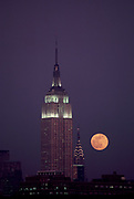 Empire State bulidng and Chrysler building with Full Moon rising