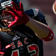 Santa Ana College defensive back Kevin Denno makes a catch during pre-game warm-ups on Saturday, Nov. 8, 2014 at Santa Ana Stadium in Santa Ana, Calif. The Dons fell to Grossmont College, 30-23. (Photo by Hailey Archambault/Sports Shooter Academy XI)