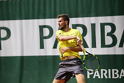 May 23, 2019 - Paris, France - Oscar Otte of Germany in action during a match against Guillermo Garcia-Lopez of Spain in the  third round qualifications of Roland Garros, in Paris, France, on May 22, 2019. (Credit Image: © Ibrahim Ezzat/NurPhoto via ZUMA Press)