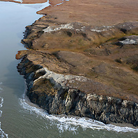 Sept 2009 Yamal Peninsula, Siberia, Russia - global warming impacts story on the Nenet people , reindeer herders in the Yamal Peninsula weather station marselley melting permafrost on the cliffs