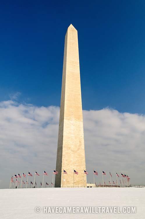 The Washington Monument stands out against a clearing blue sky after a recent snow storm dumped more than a foot of snow on the area.