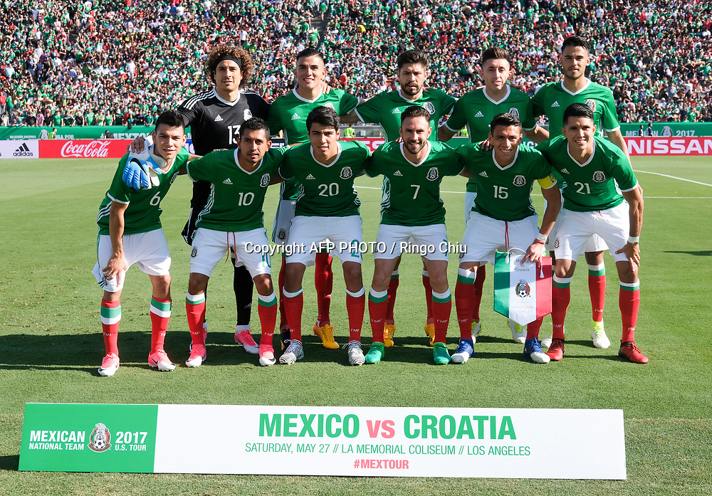 Mexico National team pose for photo before an international friendly soccer game against Croatia at LA Memorial Coliseum on May 27, 2017 in Los Angeles, California. Croatia won 2-1.  AFP PHOTO / Ringo Chiu
