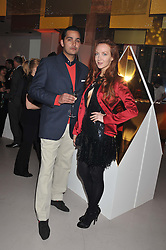 OLIVIA GRANT and JOSEPH KATZ at the unveiling of the Helena Christensen and Swarovski Crystallized Unsigned Model search winners held at Swarovski Crystallized, 24 Great Marlborough Street, London on 26th January 2012.