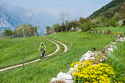 Mountainbiker riding along country path