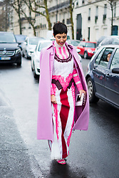 Chrisa Pappas wears a pink coat, a pink pattern dress with glitter and embroidery, outside Valentino, during Paris Fashion Week Womenswear Fall/Winter 2018/2019, on March 4, 2018 in Paris, France.  (Photo by Nataliya Petrova/NurPhoto/Sipa USA)