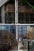 A utopian future landscape merging with a background construction hoarding, on 16th February 2017, in the City of London, England.