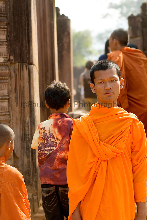 Angkor Wat Cambodia monk in solemn stance