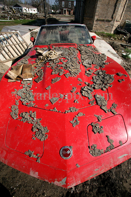 30 Jan, 2006. New Orleans, Louisiana. Post Katrina.<br />  A collectors' 1970's Corvette Stingray remains filled with mud and debris from the 17th street canal breach in Lakeview. The car sits in the driveway of a house a few hundred feet from where the levee breached. Much of the city remains in ruins 5 months after hurricane Katrina destroyed the levees, flooding the area.<br /> Photo; Charlie Varley/varleypix.com