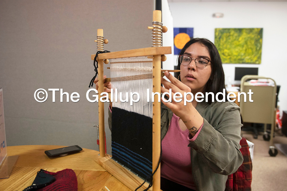 Naakai Asdzaan weaves a purse at a Navajo rug weaving class hosted by Lois Becenti, Friday, Jan. 17 at the Octavia Fellin Public Library in Gallup. Asdzaan is weaving a purse to sell at the Gallup Flea Market.