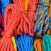 Brightly colored ropes for sale at a market in Antigua Guatemala. Famous for its well-preserved Spanish baroque architecture as well as a number of ruins from earthquakes, Antigua Guatemala is a UNESCO World Heritage Site and former capital of Guatemala.