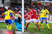 Goal! Kayden Jackson of Wrexham squeezes the ball over the line during the Vanarama National League match between Wrexham AFC and Kidderminster Harriers at the Glyndŵr University Racecourse Stadium, Wrexham, United Kingdom on 23 February 2016. Photo by Mike Sheridan.