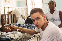 Liam Payne With 7 month old Desirue, and her mum Philomina, at Paediatric ward Princess Mary Louise Hospital, Accra, Ghana