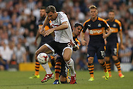Ayoze Perez of Newcastle United pulls back Kevin McDonald of Fulham. Skybet EFL championship match, Fulham v Newcastle Utd at Craven Cottage in Fulham, London on Friday 5th August 2016.<br /> pic by John Patrick Fletcher, Andrew Orchard sports photography.
