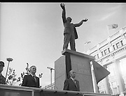 Jim Larkin Statue. O'Connell Street Dublin.   (M77)..1979..15.06.1979..06.15.1979..15th June 1979..Today saw the unveiling of a statue in memory of James (Big Jim) Larkin. Larkin was a trade union activist who was a thorn in the side of many employers who refused to allow workers join unions. A dispute with The Dublin United Tramway Company  escalated into what is now known as the great lock out. Employers banded together and wanted workers to sign a pledge stating that they would not join Larkin's union the Irish Transport And General workers Union (ITGWU). The lock out lasted seven months. During this time Larkin was nited for his rhetoric in standing up for the poor and oppressed within Irish Society...Jim Larkin: Born Jan 21 1876 .Died Jan 30 1947...Image of the statue of James Larkin in his now famous pose, towering above the President,Dr Patrick Hillery.