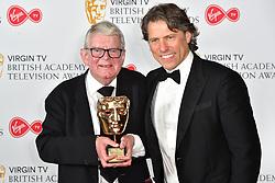 John Motson with his special BAFTA Award, and John Bishop, at the Virgin TV British Academy Television Awards 2018 held at the Royal Festival Hall, Southbank Centre, London.