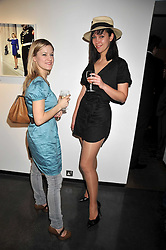 Actress RHIANNON ELLISON SAYER and LOLA LABELLE at an exhibition of photographs by Miles Aldridge held at Hamiltons, Carlos Place, London on 31st March 2009.