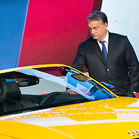Viktor Orban prime minister of Hungary checks the first Audi TT Roadster after it is introduced during the official production launch event in the Audi factory in Gyor (about 120 km West of Budapest), Hungary on November 05, 2014. ATTILA VOLGYI