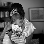 Baby Luca is comforted by Jane at their home in Sydney, Australia on 31st March 2009. Photo by Tim Clayton.