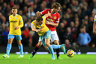 James McArthur of Crystal Palace tackles Daley Blind of Manchester United - Manchester United vs. Crystal Palace - Barclay's Premier League - Old Trafford - Manchester - 08/11/2014 Pic Philip Oldham/Sportimage