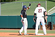 28 May 2016: Nova Southeastern's Andres Visbal (center) waives towards the dugout after getting a hit. The Nova Southeastern University Sharks played the Franklin Pierce University Ravens in Game 3 of the 2016 NCAA Division II College World Series  at Coleman Field at the USA Baseball National Training Complex in Cary, North Carolina. Nova Southeastern won the game 4-3 in twelve innings.