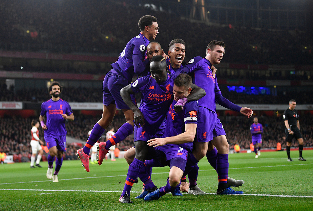 Liverpool's players celebrate James Milner's (C) scoring the 1-0 goal during the Premier League Soccer match between Arsenal FC and Liverpool FC at the Emirates Stadium in London, Britain, 03 November 2018. <br /> <br /> EDITORIAL USE ONLY. No use with unauthorized audio, video, data, fixture lists, club/league logos or 'live' services. Online in-match use limited to 75 images, no video emulation. No use in betting, games or single club/league/player publications